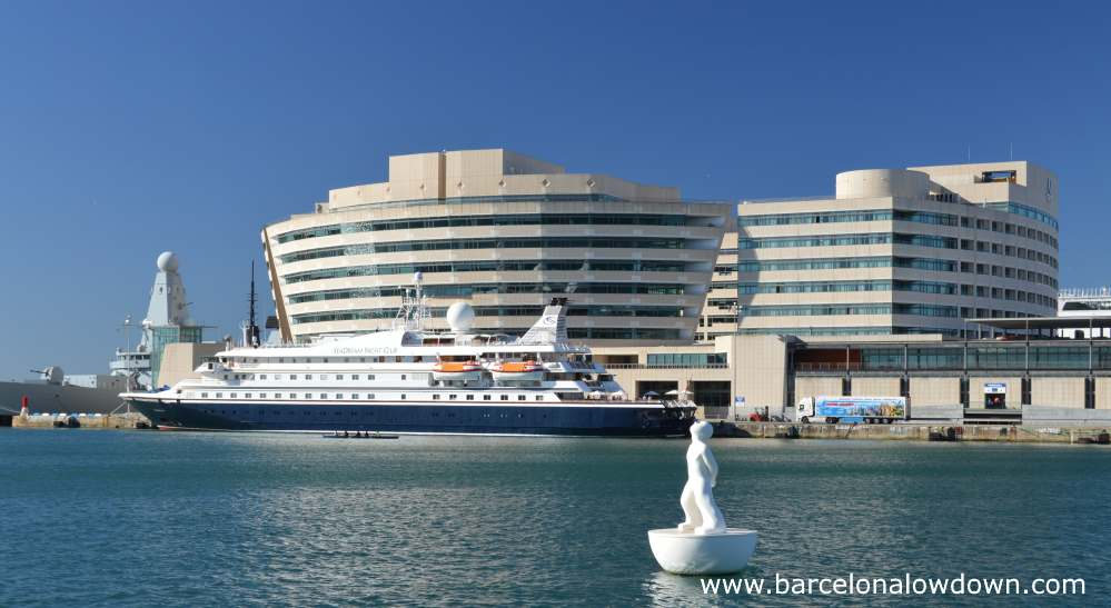 A smaller ship docked at the Barcelona Cruise pier North Terminal