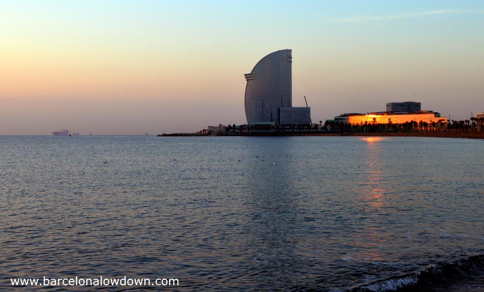 The so called sail hotel which is one of the tallest skyscrapers in Barcelona at sunrise