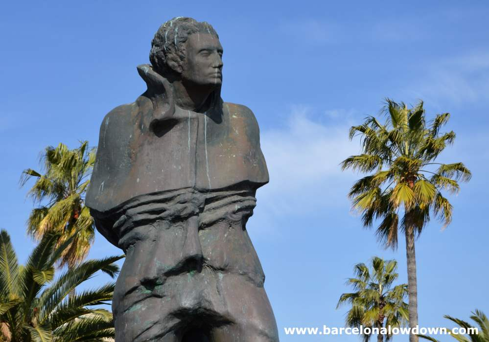 Close up photo of the monument to Catalan poet Joan Salvat-Papasseit. In this photograph you can clearly see the expression, and the bird droppings, on the statues face.