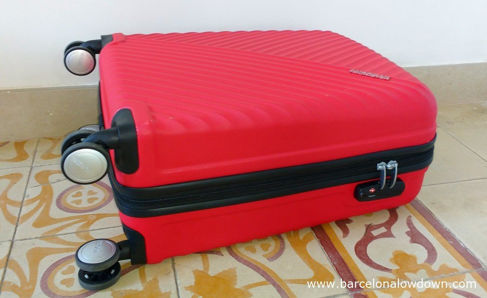 5171460b4725 A red hand luggage size American Tourister suitcase with a built in  combination lock