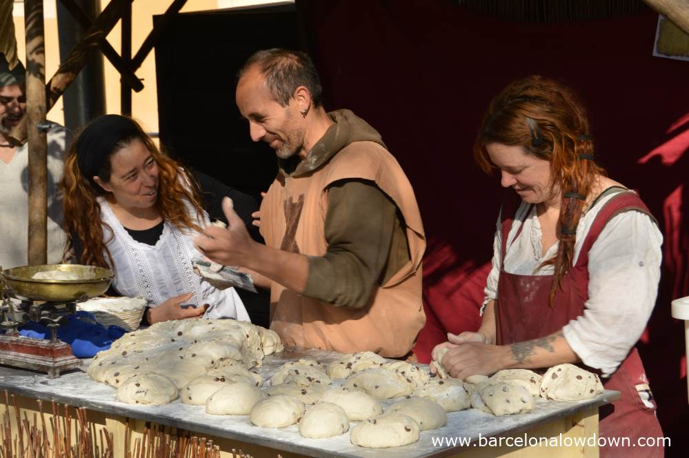 Bakers making bread during Manresa medieval fair la Fira de l'Aixada