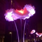 Giant iluminated flowers, part of the Barcelona light festival in Poblenou