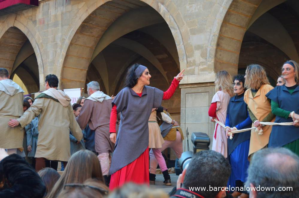 A group of actors in a play about witch hunts during Manreas medieval fair