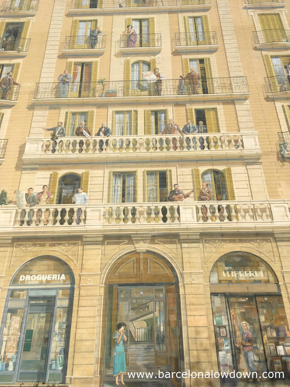 Life size mural of a building painted on the side of a building in Barcelona's L'Eixample neighbourhood
