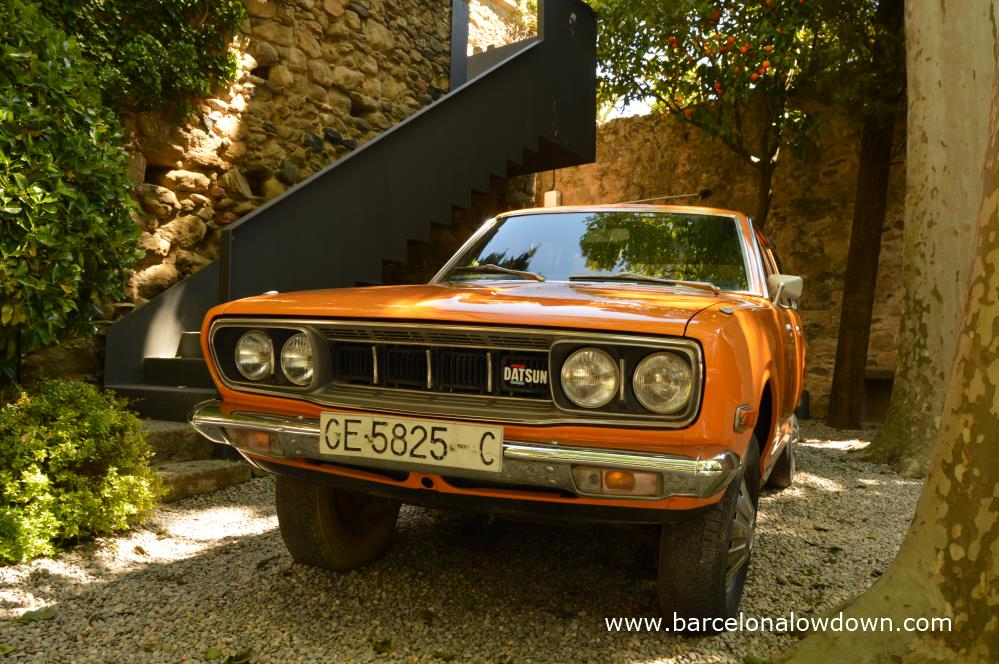 Salvador Dali's orange Datsun 610 in the garden of Pubol castle
