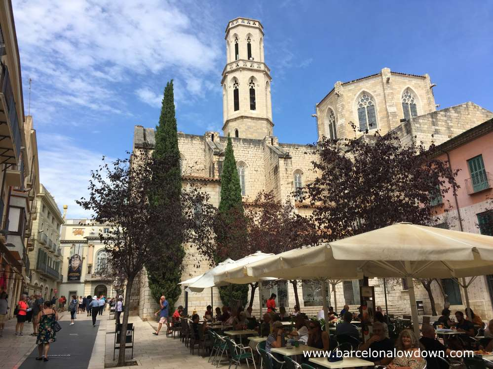 A street cafe in a square in front of the church of Sant Pere, Figueres, Catalonia Spain