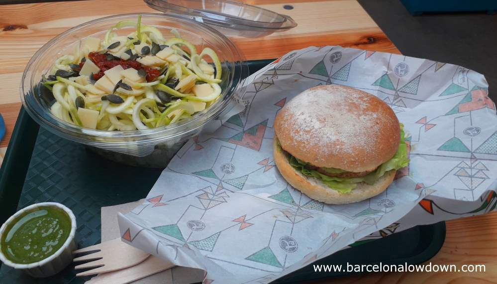 Vegan burger with avocado and salad served on a tray, fst food style at the Trocadero restaurant near the Sagrada Familia, Barcelona