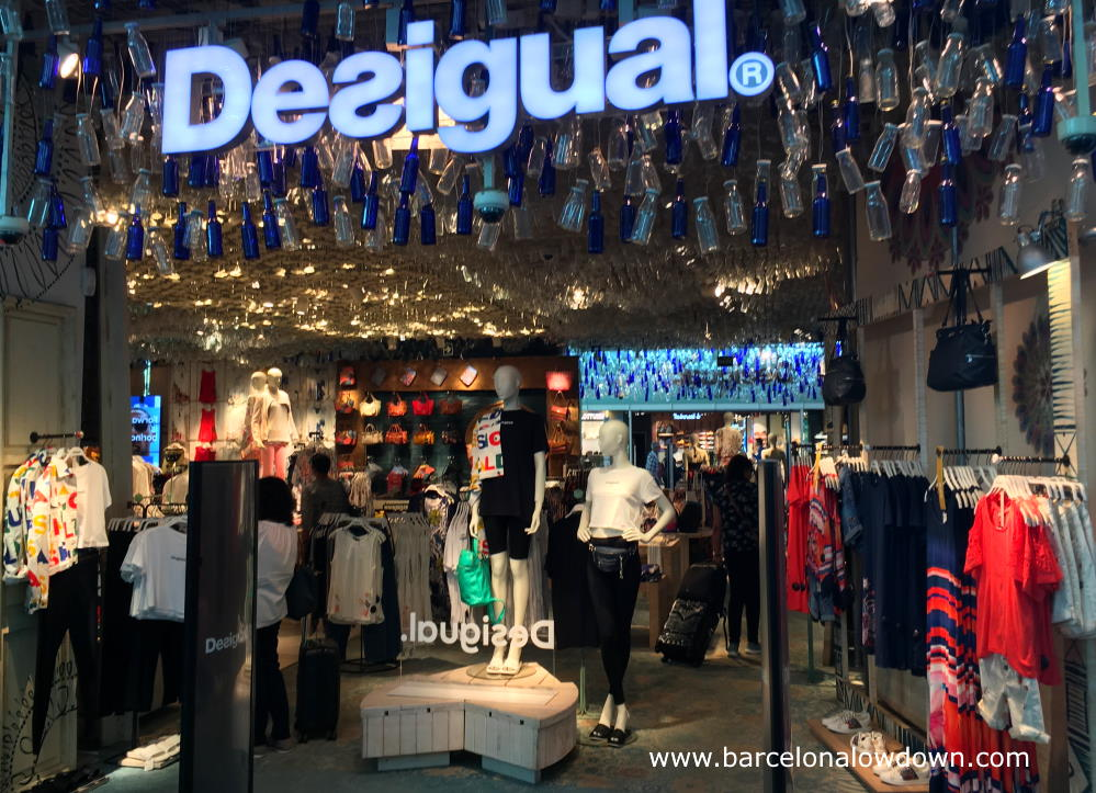 Clothes and dresses in the Desigual store at Barcelona airport