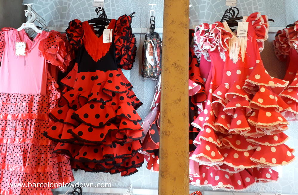Souvenir flamenco dresses on display in a shop at Barcelona airport