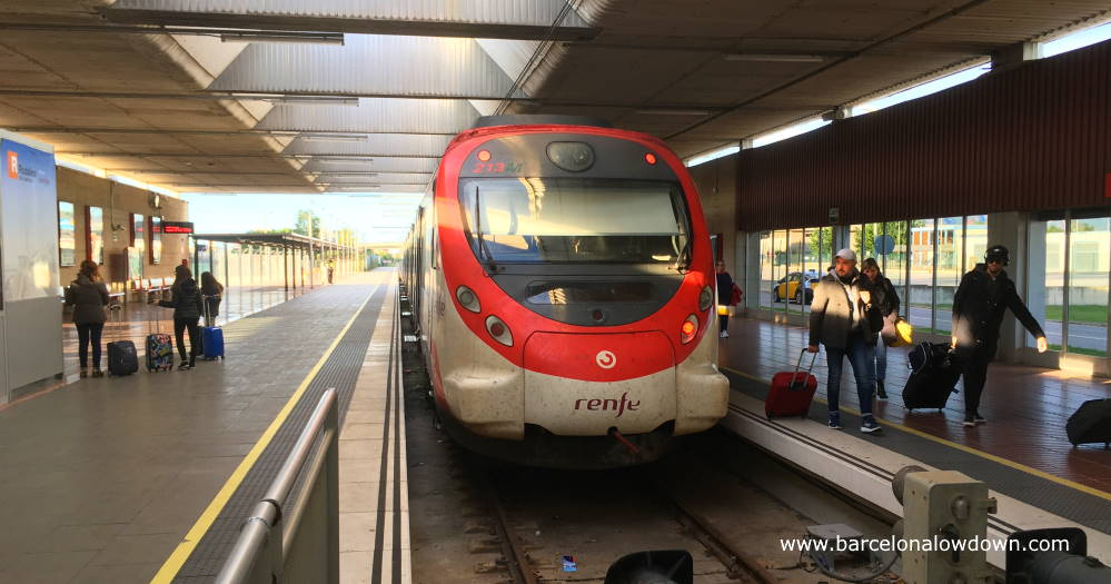 Passengers alighting from the train at Barcelona airport terminal 2