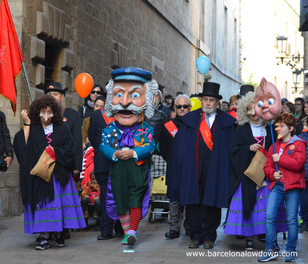 The traditional Nose Man Parade through the narrow streets of Barcelona's Gothic Quarter