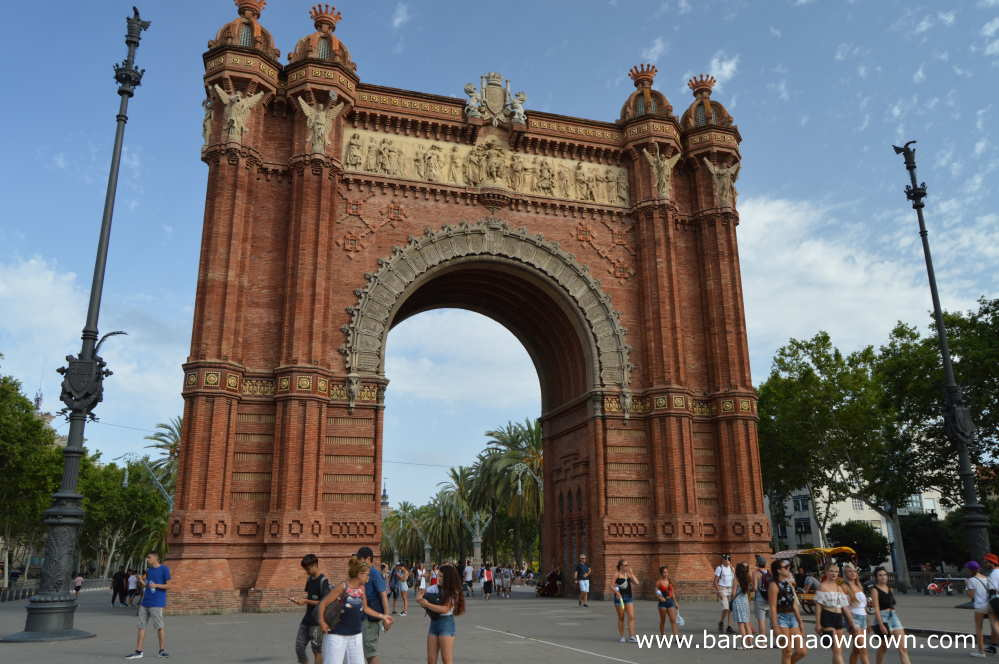 Tourists below the Arc de Triomf in summertime Barcelona