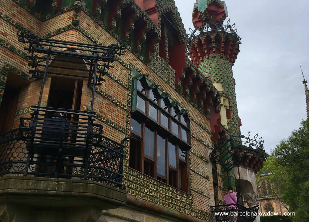 The exterior of the el Capricho Gaudi house is decorated with ceramic tiles with 3 d yellow sunflowers