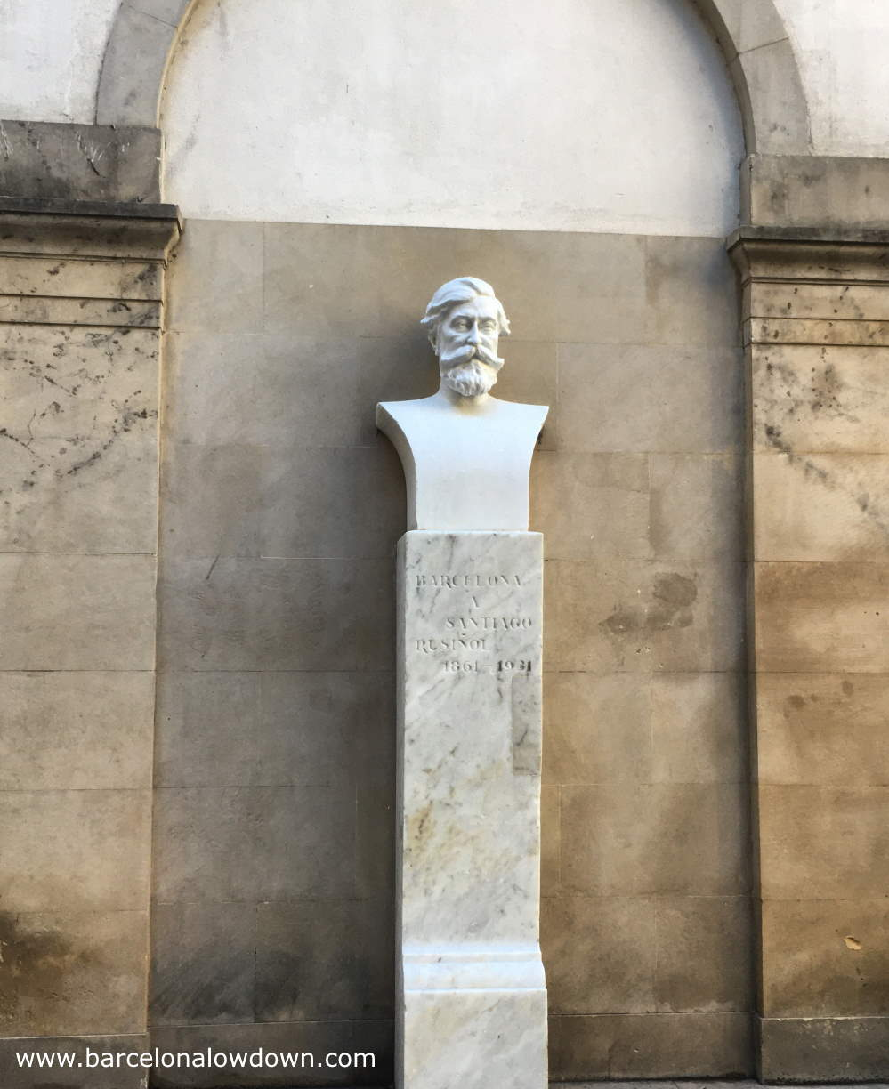 White bust of Catalan artist Santiago Rusiñol on a tall white marble plinth