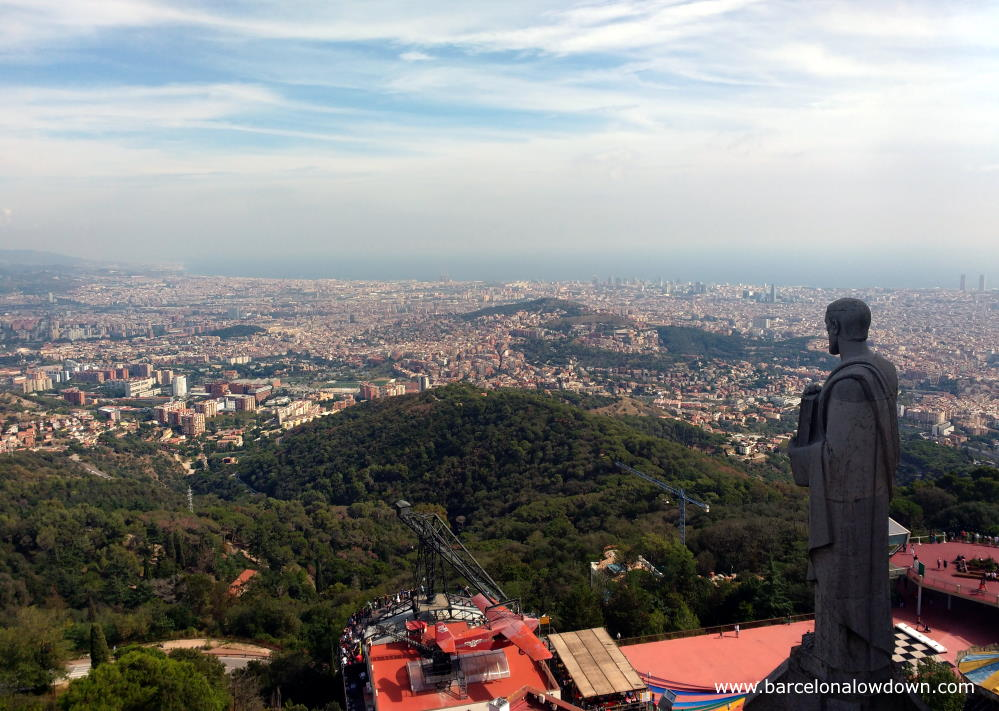 Panoramic view of Barcelona and the Tibidabo amusement park from the Temple Expiatori del Sagrat Cor church