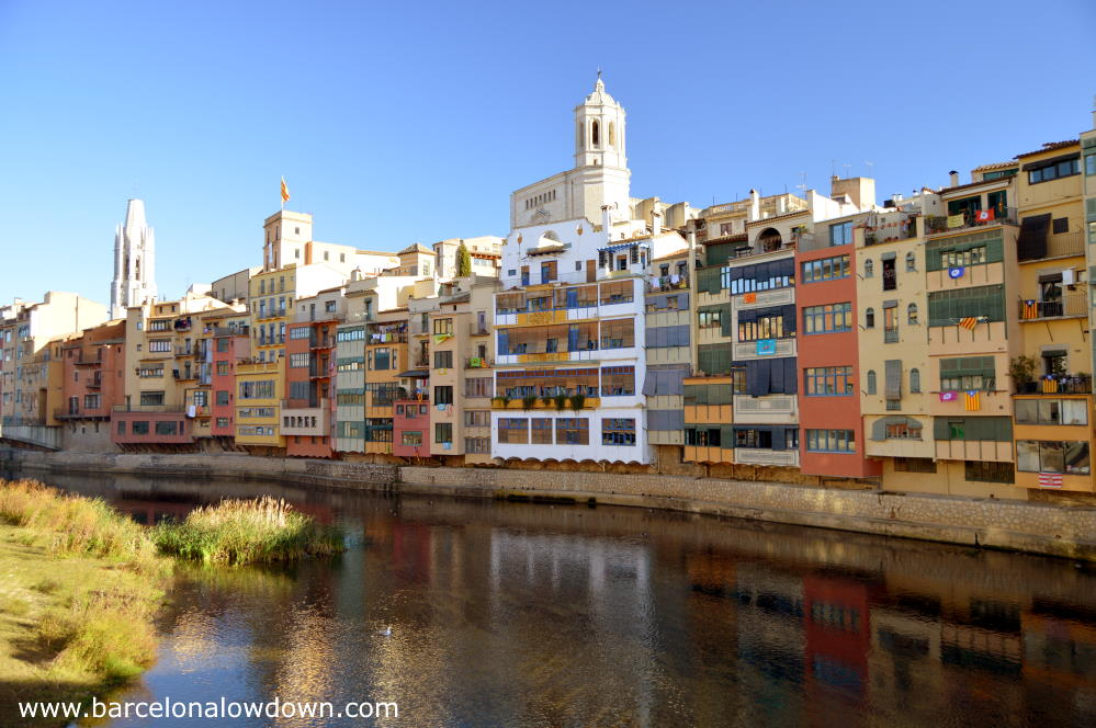 View of Girona from one of the bridges over the Onyar river, you can see the cathedral and the famous colorful houses