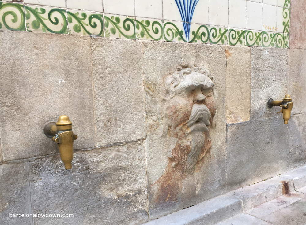 Close up photo of one of the remaining medieval fountains in Barcelona Gothic Quarter