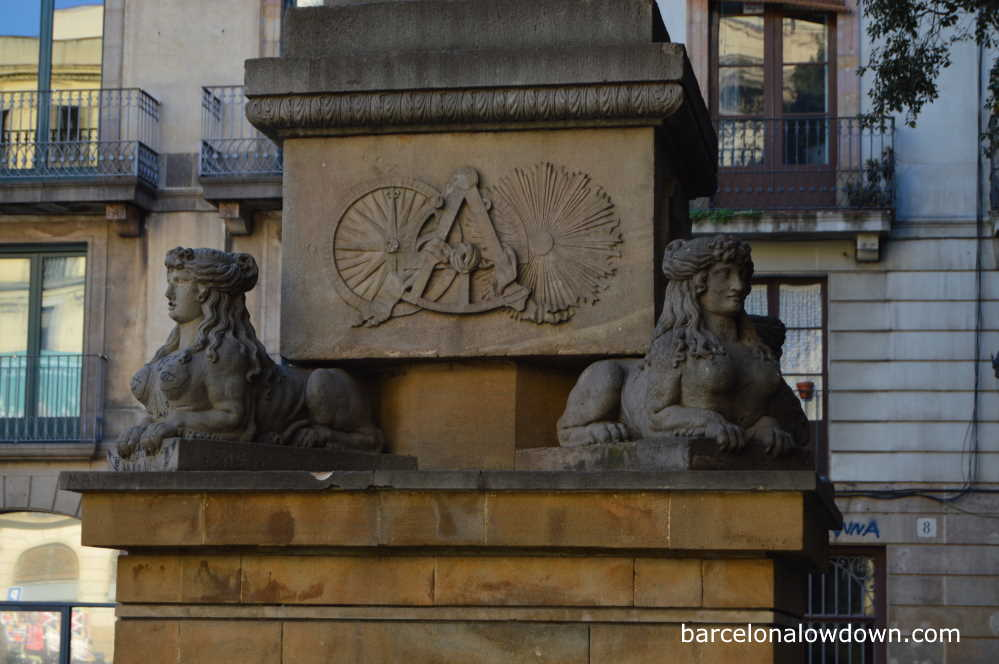 Sphinxes and masonic symbols on the base of Neptune's fountain, Barcelona, Spain