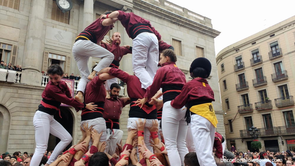A group of Castellers building a human tower in front of Barcelona Town Hall