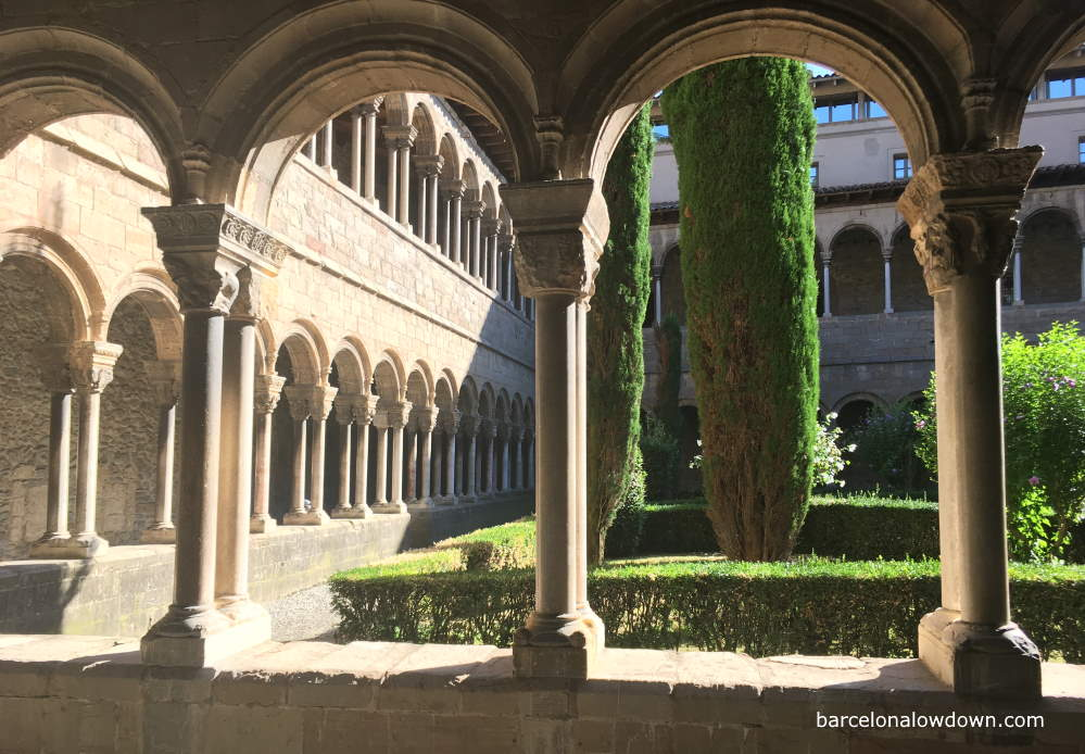 Arches and pillars inside the cloisters of Santa Maria de Ripoll Monastery