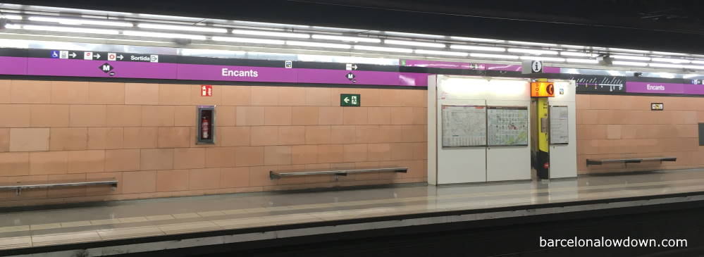 Signs above the platform on the Barcelona subway system