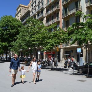 A family walking in the Eixample district of Barcelona