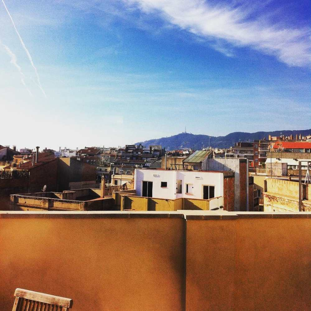 Looking out over the rooftops in Barcelona with the Collserola mountain range in the background