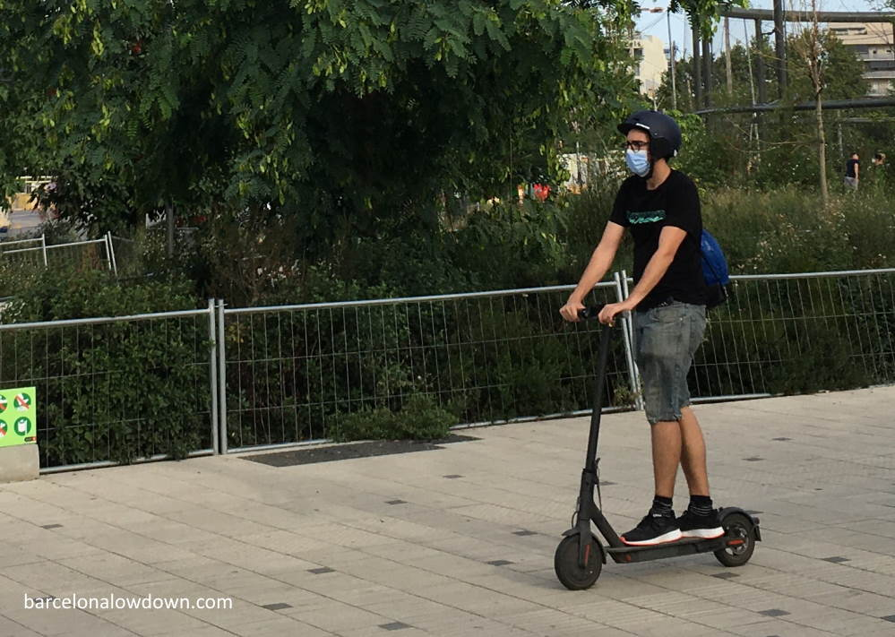 Riding an electric scooter in a park in Barcelona, Spain