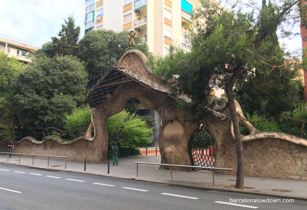 The lobed modernist gateway and stone walls that once surrounded the Miralles estate in Barcelona, Spain