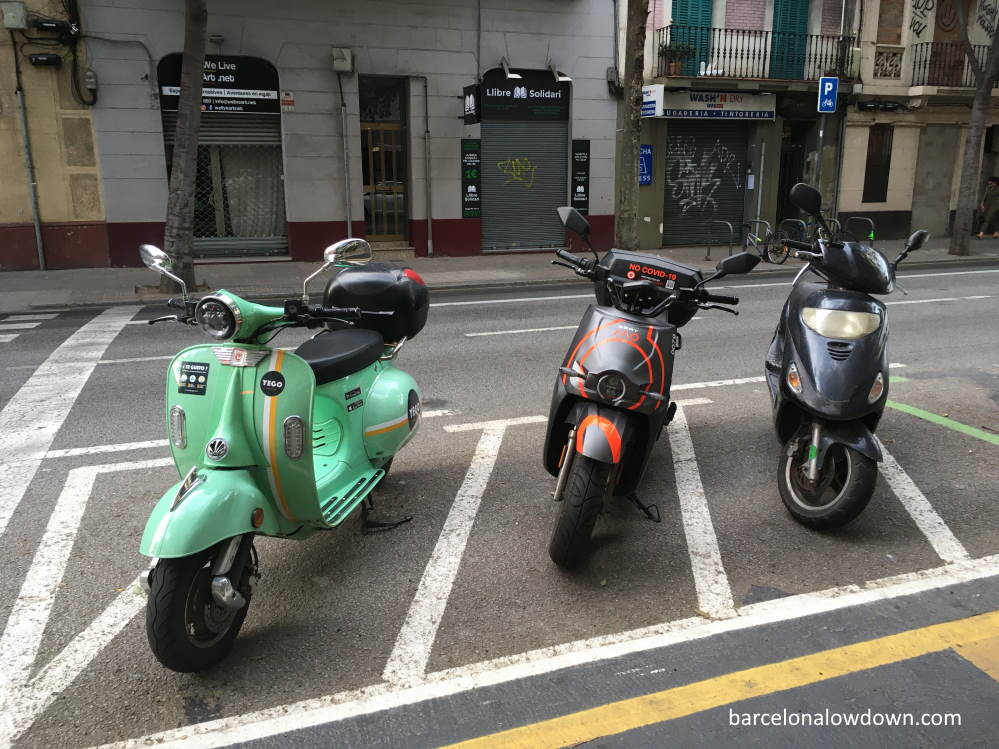 Electric scooters parked on the road in Barcelona, Spain